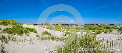 Beautiful dune landscape with traditional lighthouse at North Sea, Schleswig-Holstein, North Sea, Germany