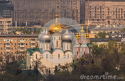 Orthodox Novodevichy Convent in Moscow on a background of city houses under summer sun