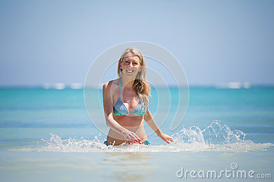 Smiling woman coming out of water