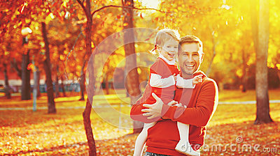 Happy family father and child daughter on a walk in autumn leaf