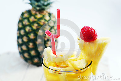 Fresh juice with pineapple slice