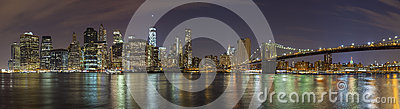 Manhattan skyline at night, New York City panoramic picture.
