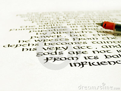 Calligraphy pen and writing on white paper