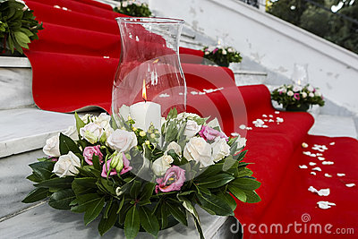 Wedding red carpet with white candles in church stairs