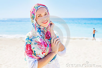 Muslim caucasian (russian) woman wearing red dress