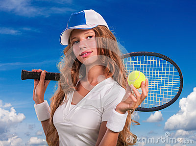 Girl  holding tennis  racket and ball on blue sky