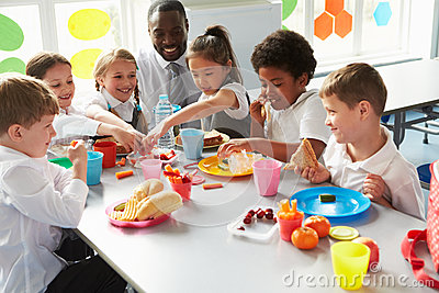 Group Of Children Eating Lunch In School Cafeteria