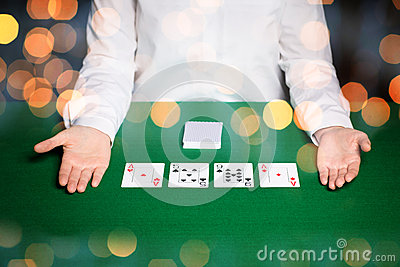 Holdem dealer with playing cards over lights