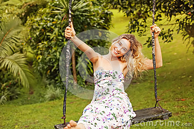 Pretty woman on a swing