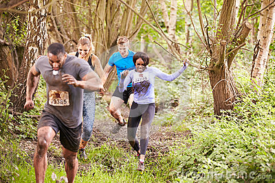 Competitors running in a forest at an endurance event