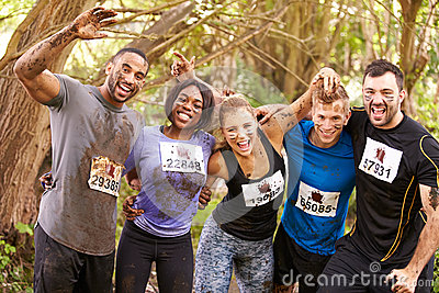 Competitors celebrate completing an endurance sports event
