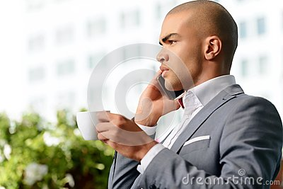 Pleasant businessman drinking coffee