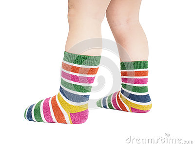 Toddler standing in striped socks and bare legs