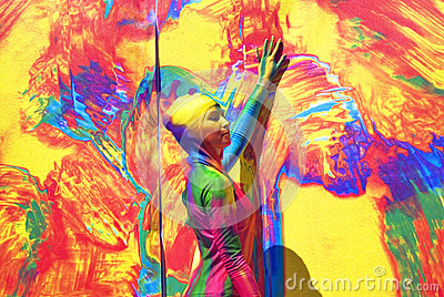Woman poses for fotos at colorful background.