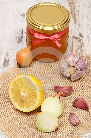 Onion, garlic, lemon and honey in glass jar, healthy nutrition and strengthening immunity
