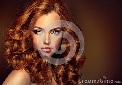 Girl model with long curly red hair.