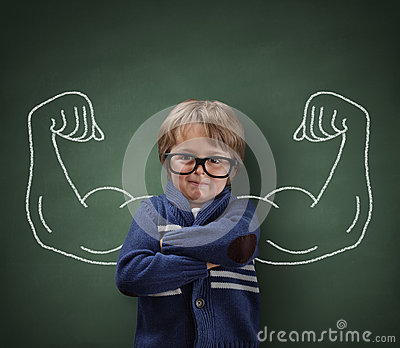 Strong man child showing bicep muscles