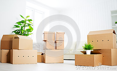 Move. lots of cardboard boxes in empty new apartment
