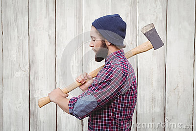 Side view of hipster with axe