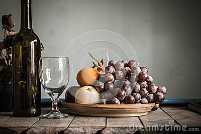 Fruit tray and a bottle