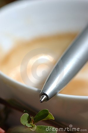 Pen on coffee cup