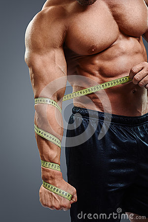 Bodybuilder with tape measure