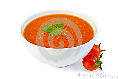 Soup tomato in white bowl with cherry tomatoes