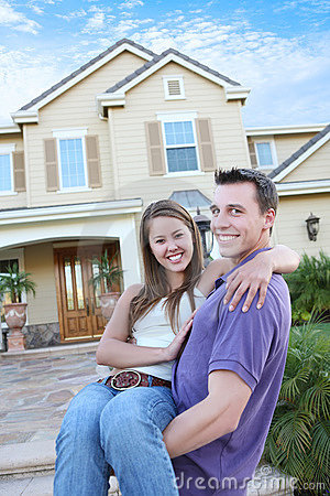 Couple in Love in Front Home (Focus on Woman)