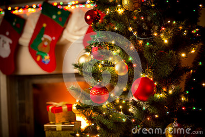Decorated fireplace and Christmas tree at cottage