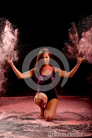 Contemporary dance girl throwing pink powder