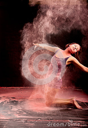 Dancer expressing pink powder