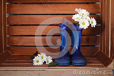 Blue rubber boots with spring flowers