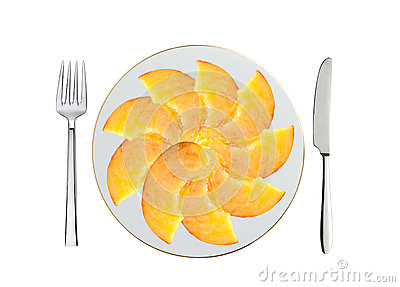 Fresh peach slices on white plate, spoon and fork isolated