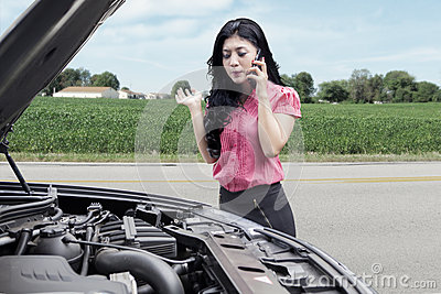 woman with broken car asking help on the road
