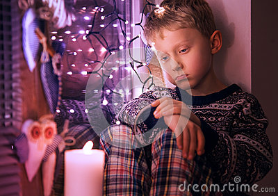 Sad Little boy waiting for Christmas presents