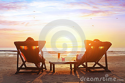 Couple enjoy luxury sunset on the beach