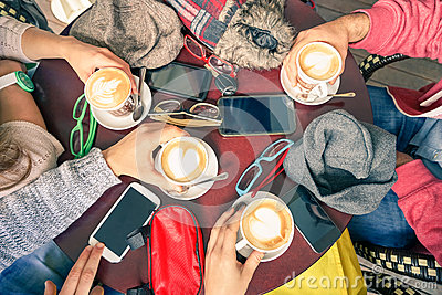 Group of friends drinking cappuccino at coffee bar restaurants