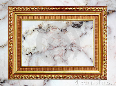 Gold frame Vintage photo frame on marble stone wall background