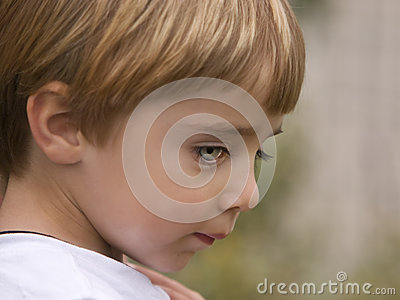 Shy Child with Blue Green Eyes