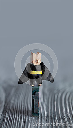 Leadership conceptual image. Clothespin superhero
