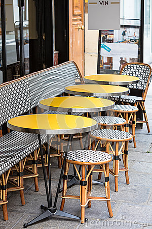 Open cafe terrace, round tables and wicker chairs, Paris, France