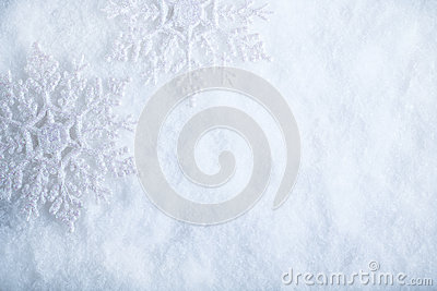 Two beautiful sparkling vintage snowflakes on a white frost snow background. Winter and Christmas concept