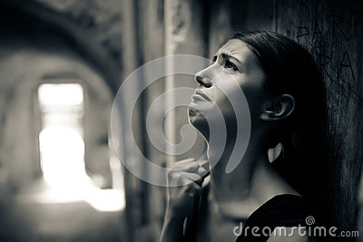 Woman with sad face crying.Sad expression,sad emotion,despair,sadness.Woman in emotional stress and pain.Woman sitting alone on th