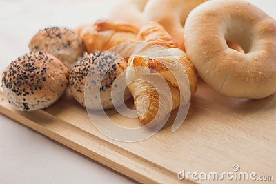 Fresh bread  on the wooden board and white background
