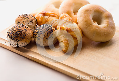Fresh mix bread on the wooden board and white background