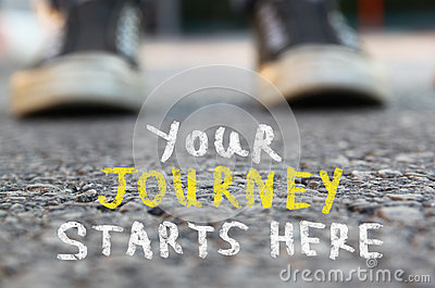 Image with selective focus over asphalt road and person with handwritten text - your journey starts here. education and motivation
