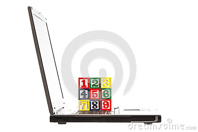 Laptop and wooden Blocks with numbers isolated on white