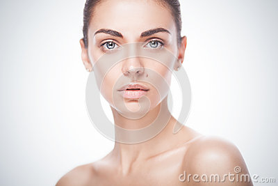 Closeup portrait of young adult woman with clean fresh skin