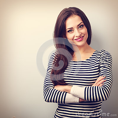 Beautiful confident casual woman with folded hands looking happy