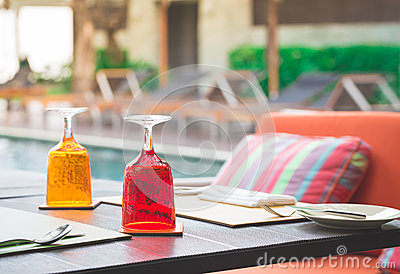 Red and Yellow Glass of water on luxury table setting